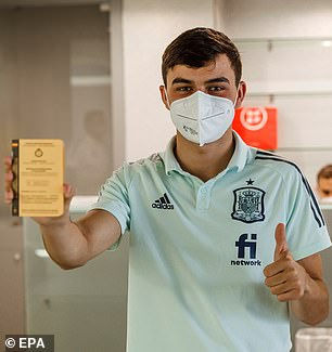 Moreno's Spain team-mate Pedro Gonzalez also put his thumb up to cameras after being inoculated