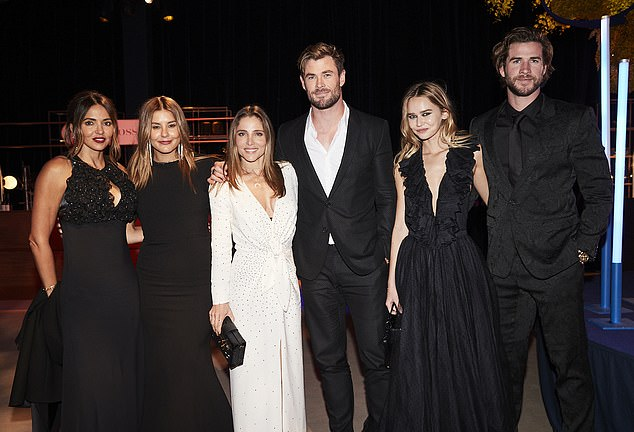 Hanging with the Hemsworths: Lauren Phillips (second from left) looked glamorous in a black gown at the Gold Dinner in Sydney alongside Chris Hemsworth, Elsa Pataky (centre), Matt Damon's wife Lucciana Barroso (left), Liam Hemsworth and Gabriella Brooks