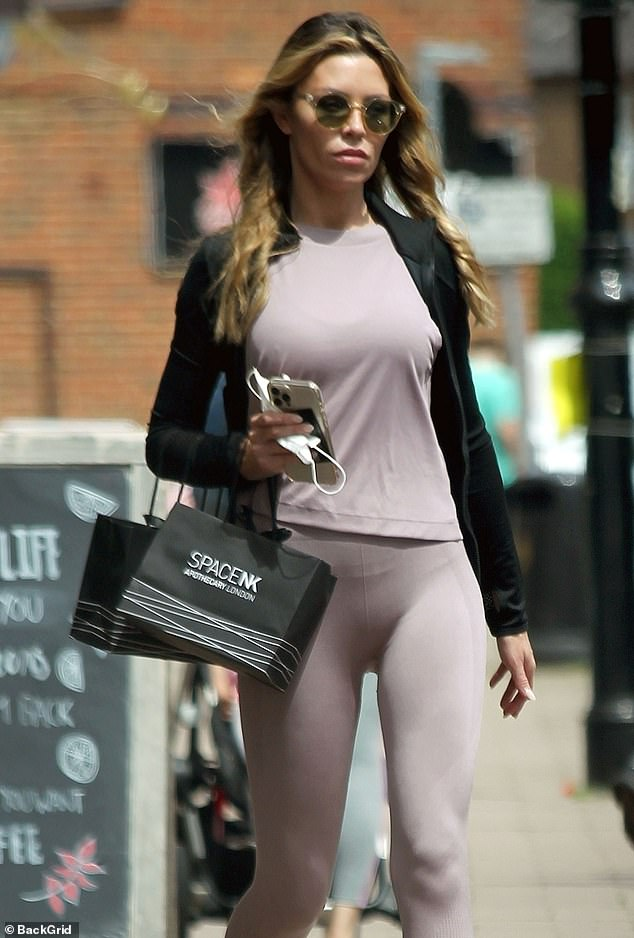 Sporty:The model looked trim in a lilac top and matching leggings that showed off her toned legs.The mother-of-three layered up with a black gym jacket and donned lilac trainers