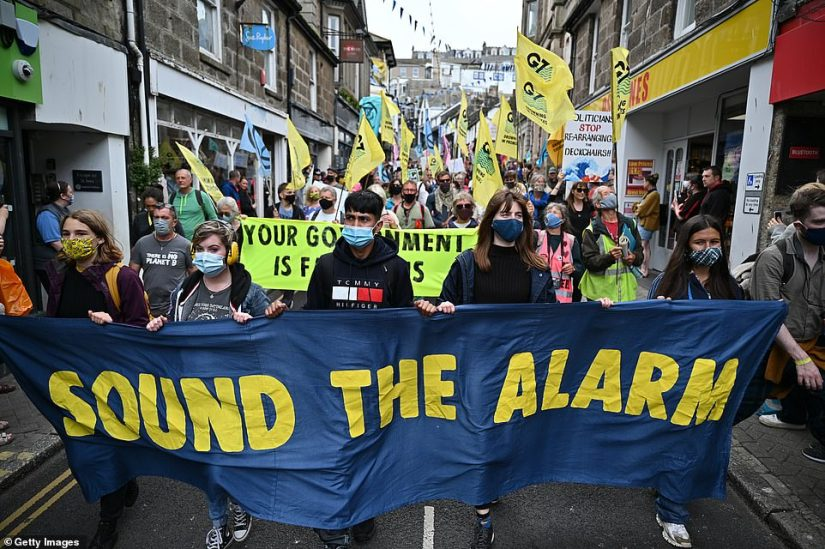 Hundreds of people poured into the narrow streets of St Ives to campaign for climate change action