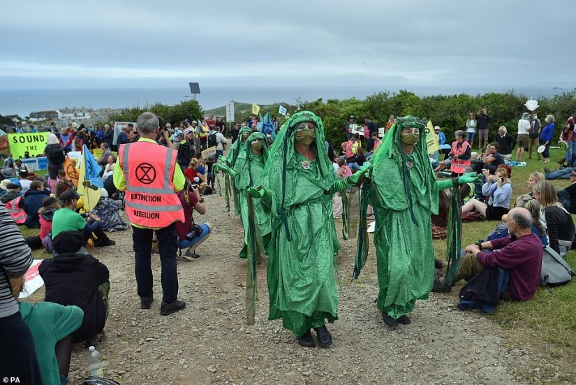 The demonstrators dressed in green made their way through the centre of the crowds in St Ives