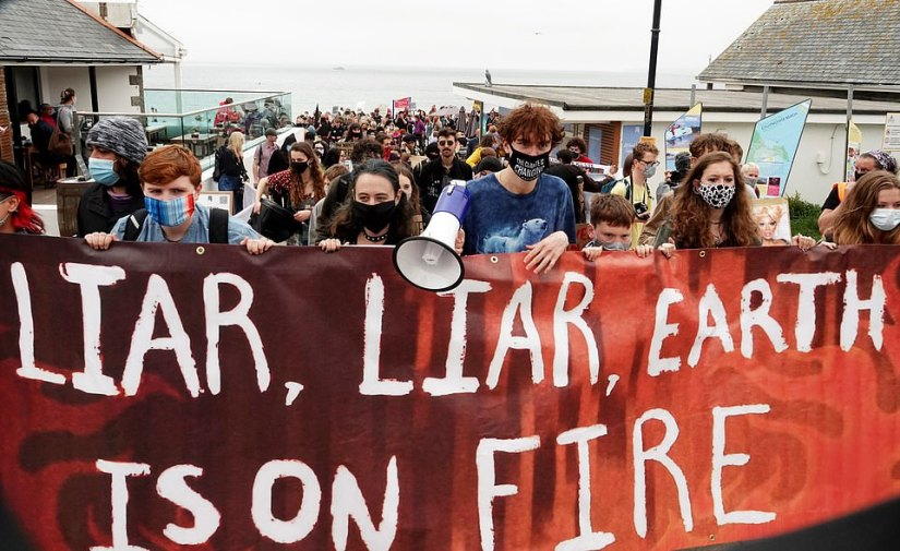 A large banner held by protesters in St Ives today read 'liar, liar, earth is on fire' as they marched