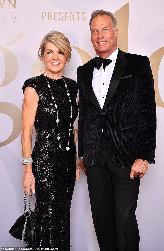 Beauty in black! Some of the country's most influential people attended the gala, including former foreign minister Julie Bishop looked glamorous in a long black gown and Van Cleef & Arpels jewels, alongsidepartner David Panton. Both pictured