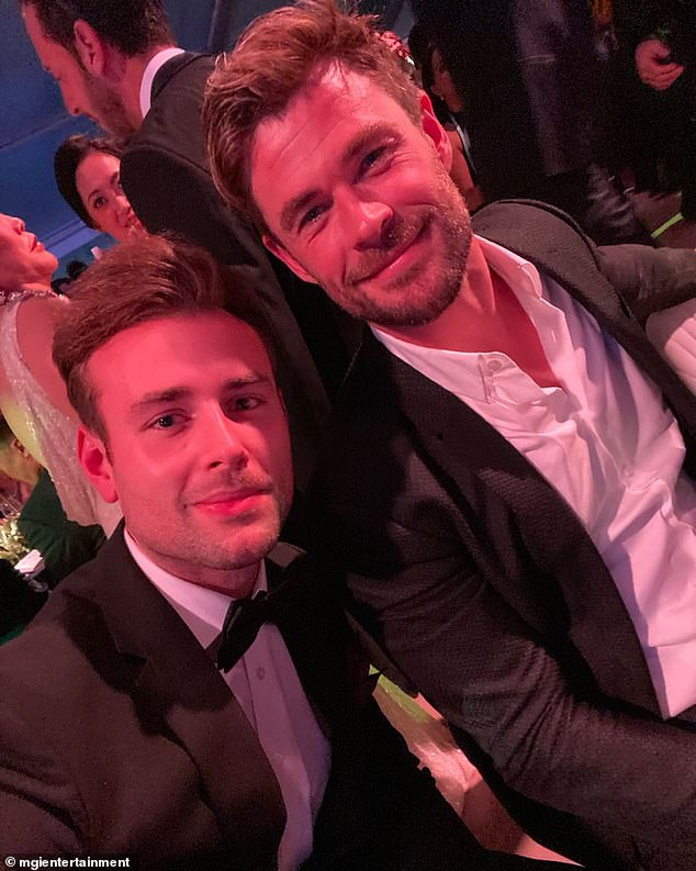 Sneaky one:Chris Hemsworth skipped the red carpet and slipped into the Gold Dinner 2021 charity event in Sydney on Thursday. Chris appears relaxed in the image, wearing a casual dinner suit and white button-up shirt without a tie. Pictured withNic Antonio