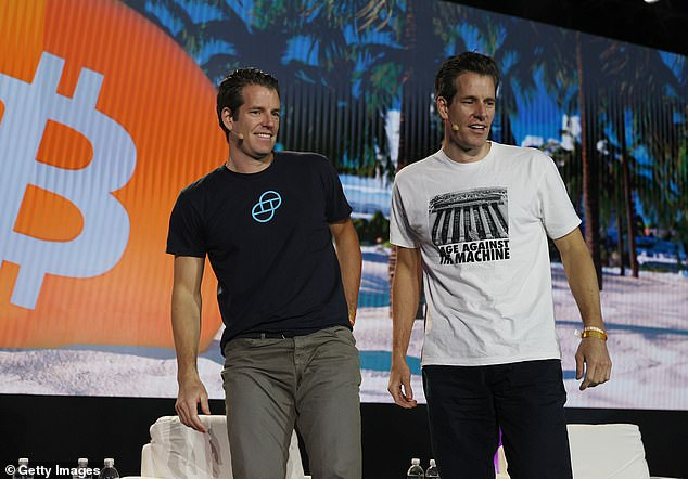 Tyler Winklevoss and Cameron Winklevoss (L-R), creators of crypto exchange Gemini Trust Co. on stage at the Bitcoin 2021