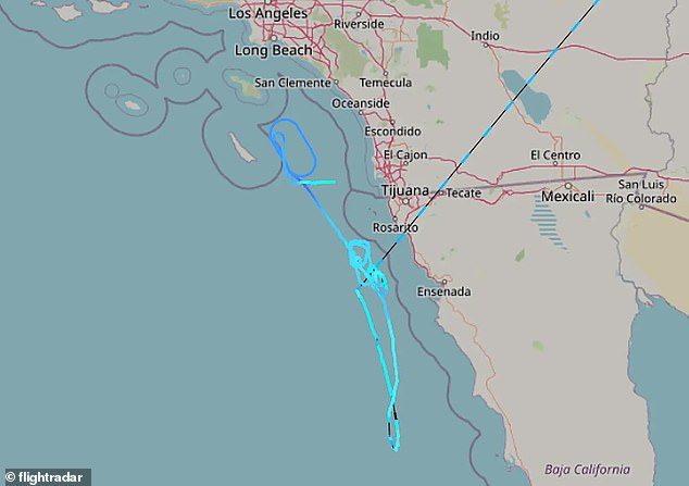 Officials are unsure what caused the loud sound, but flight tracking data showed an unidentified plane (light blue path) traveling at supersonic speeds off the coast of San Diego County around 8:20pm PST - minutes before the skyquake was heard