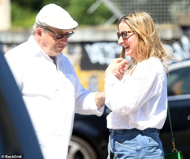 Going out: the actor looked stylish in a white shirt, dark pants and a light gray flat cap to date and wore stylish sunglasses