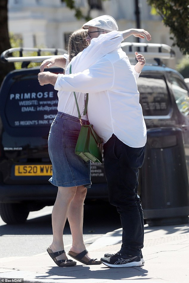 Hug: The pair embraced as they said goodbye after lunch out together