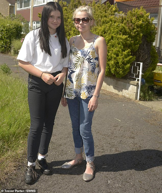 Lucy Daniels (pictured with daughter), 35, said her daughter Hayley, 13, was told her trousers showed 'too much ankle'