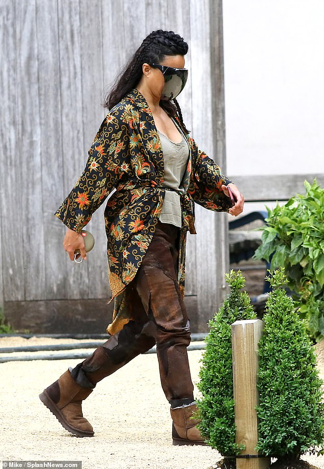 Character:The actress, 42, wore a multicoloured silk robe, brown trousers and long boots as she got to work filming scenes