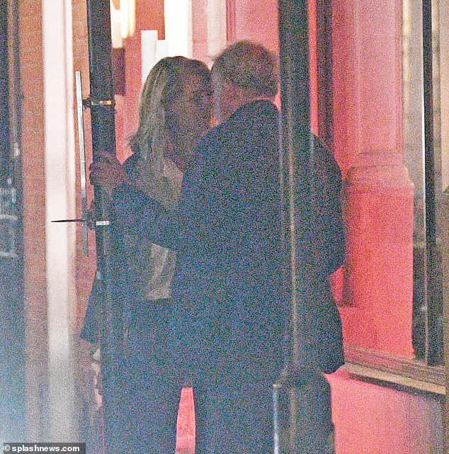Passion: Jeremy Clarkson and his girlfriend Lisa Hogan were spotted kissing passionately on the street after dinner at Tamarin Indian restaurant in Mayfair on Wednesday