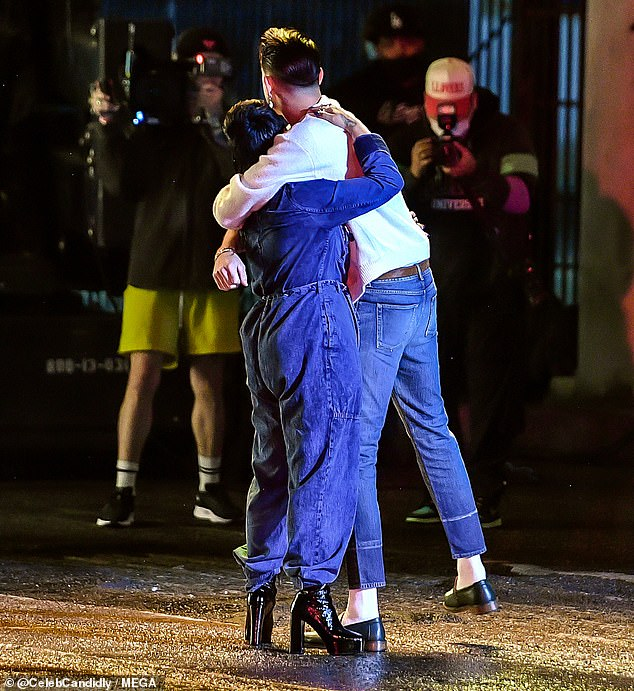 Sweet embrace: The No Limit rapper was seen hugging the Confident singer in another shot