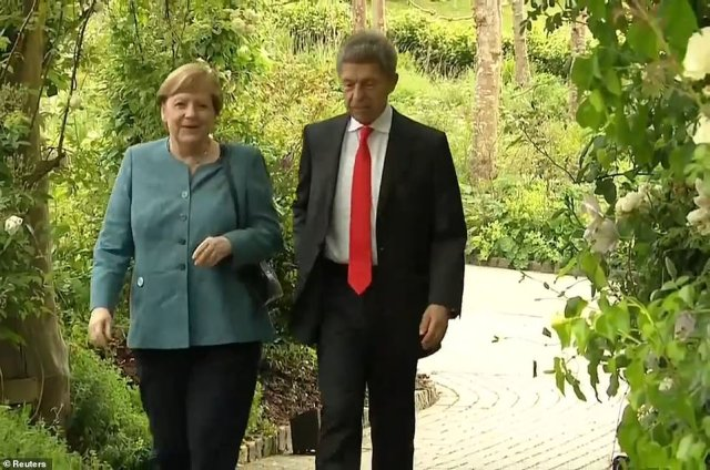 Germany's Chancellor Angela Merkel and husband Joachim Sauer were also seen arriving for the dinner tonight
