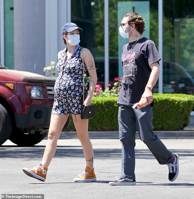 Mom and dad to be: Halsey, 26, rocked a floral romper while picking up groceries in Los Angeles at high-end organic shop Erewhon with her beau Alev Aydin, 37