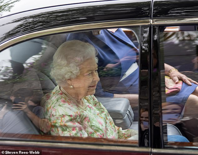 The Queen is seen in a car ahead of arriving at the Eden Project in Cornwall for a reception with G7 leaders tonight