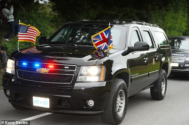 The US President's convoy of cars was flanked by eight police outriders, arriving at the venue shortly before 7pm