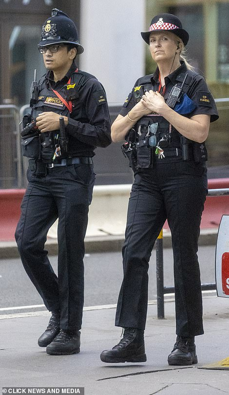Prepared:She wore the iconic police constable hat and appeared to have an earpiece whilst on duty