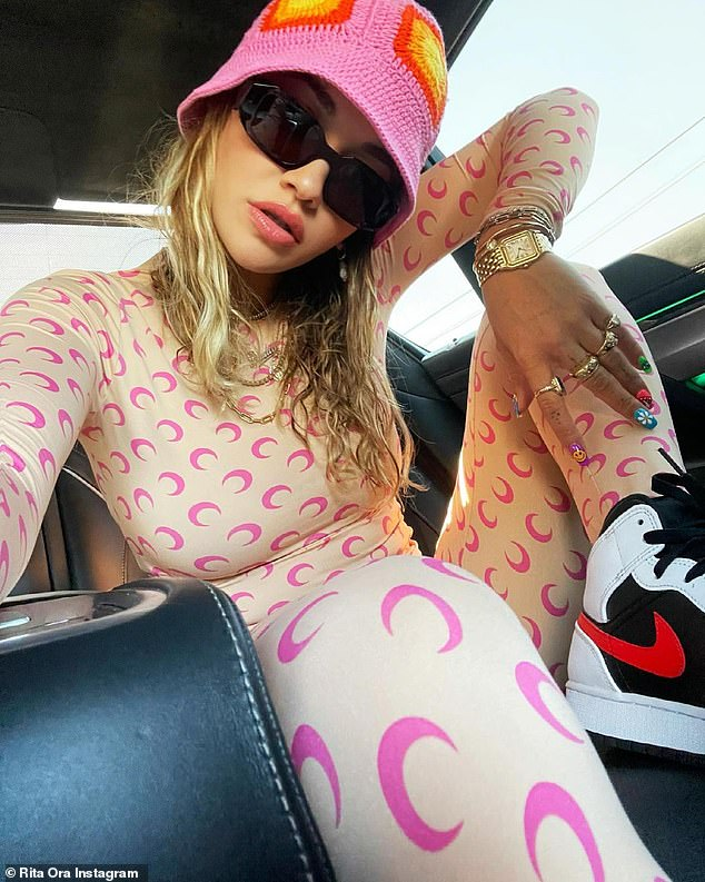 Unique: In one snap, Rita wore a matching long-sleeve peach co-ord with a pink moon pattern all over it and a pair of Nike Air Jordans