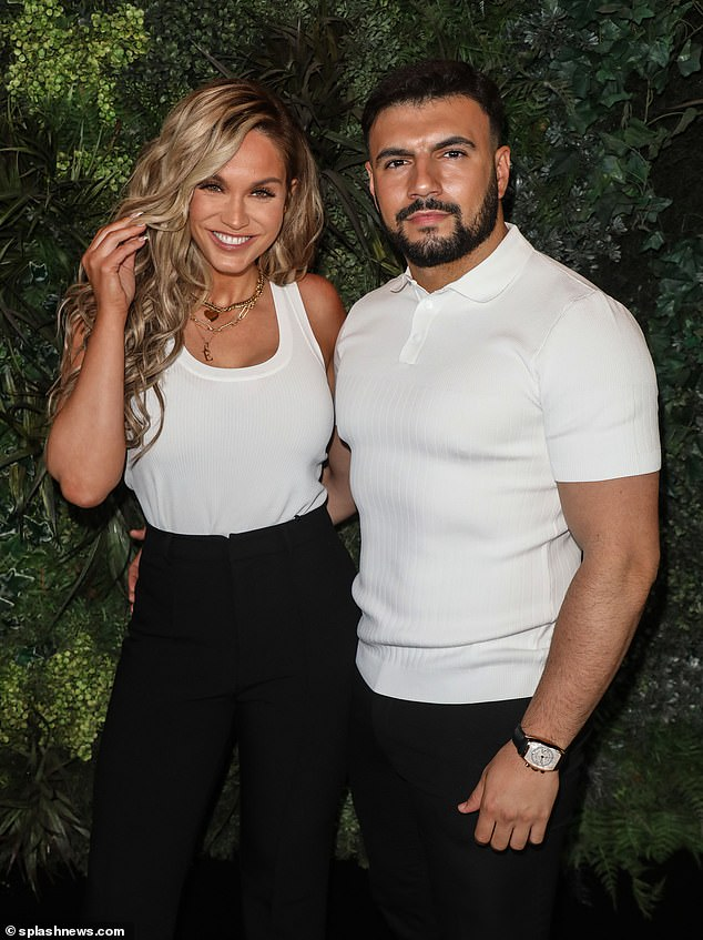 In sync! Vicky Pattison and beau Ercan Ramadan coordinated in monochrome ensembles as they cosied up together on the red carpet at Cabaret All Stars in London on Friday (pictured)
