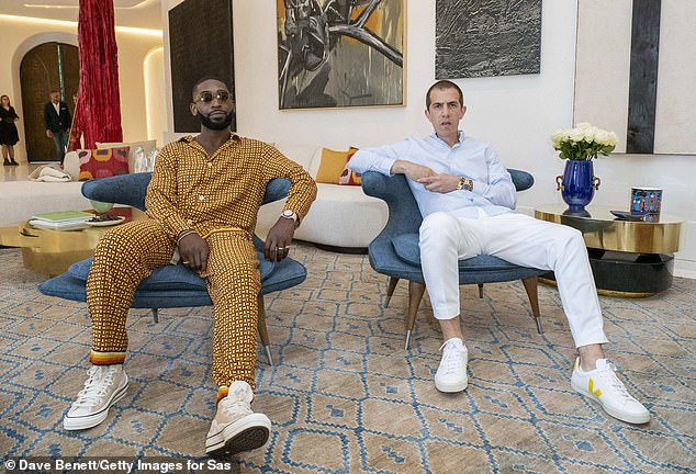Artistic: Tinie Tempah donned a quirky orange checked outfit as he attended the 'World First' NFT focused art residency in France he worked on alongside French-Iranian artistSassan Behnam-Bakhtiar (both pictured)
