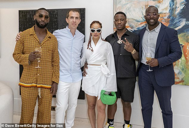 Tinie was spotted posing for photos with a number of people during his appearance at the art residency. Pictured L-R: Tinie,Sassan Behnam-Bakhtiar, Jorja Smith, Suspect and Dumi Oburota