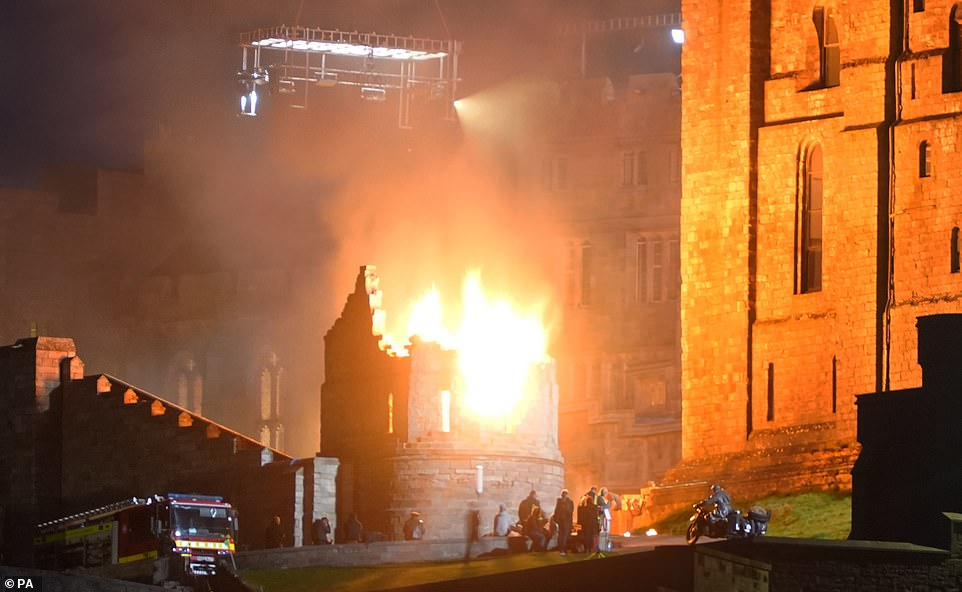 Explosive: Flames were seen lighting up the sky in the early hours of the morning in photos taken during a night shoot while a fire engine stood on standby