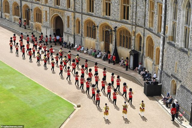 The Bands of the Household Division arrive in the Quadrangle of Windsor Castle for the scaled back event due to the pandemic