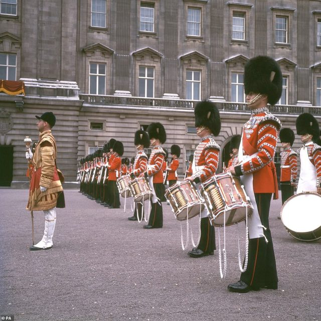 1967 — DRUM ROLL PLEASE:Members of the Guards band at Buckingham Palace, London, after Trooping the Colour.