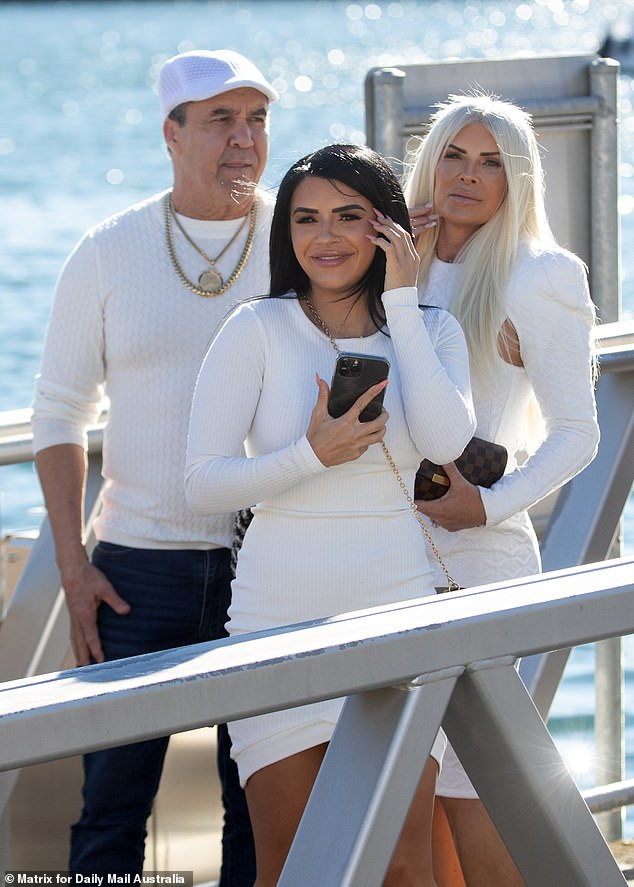Stylish: Retired professional boxer Jeff Fenech, his wife Suzee and their daughter Kayla co-ordinated their ensemble by wearing white
