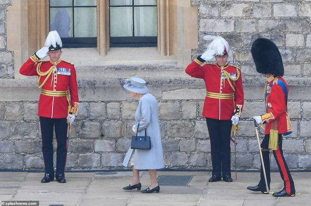 Soldiers and musicians from the Massed Band of the Household Division marched onto the parade area at Windsor Castle ahead of the ceremony
