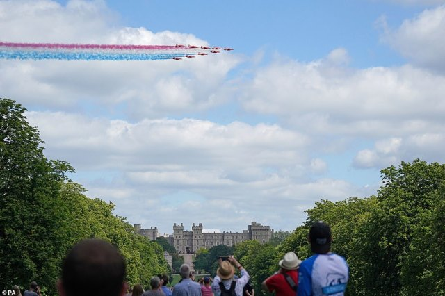 The Red Arrows fly over Windsor Castle as the Queen received her official birthday gift from the nation's armed forces