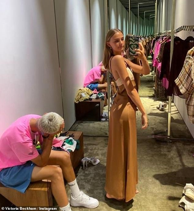 Waiting for the match: Romeo accompanied his girlfriend Mia Regan to his mother's store Victoria's Dover Street on Saturday, but couldn't hide his boredom