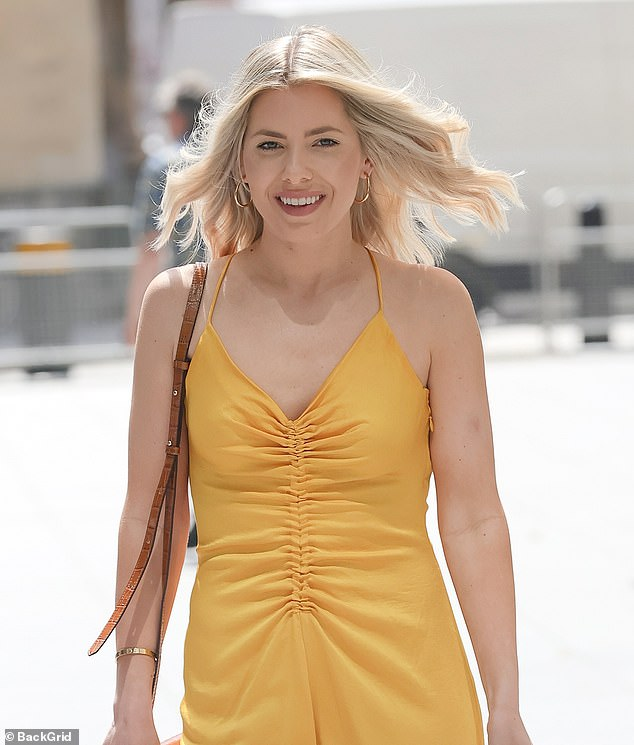 Happy: The blonde beauty looked radiant in the shin-grazing number and appeared in high spirits as strolled through the capital