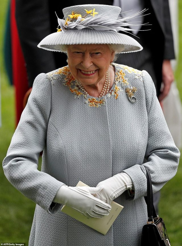 The monarch previously showcased the coat and its matching pleated hat with spike flowers, along with her signature pearls and white gloves, at Royal Ascot Ladies Day in 2019 - though it appears the coat has been modified with the addition of a set of buttons down the front of the coat