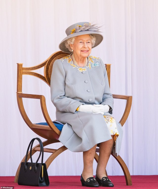 The Queen smiles as she watches on during the pomp and ceremony at Windsor Castle, her first Trooping the Colour since the death of Prince Philip