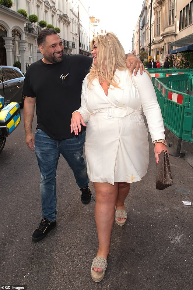 Oops: Gemma appeared to have got some of the food from the meal down herself s she left with several yellow stains on her cream outfit