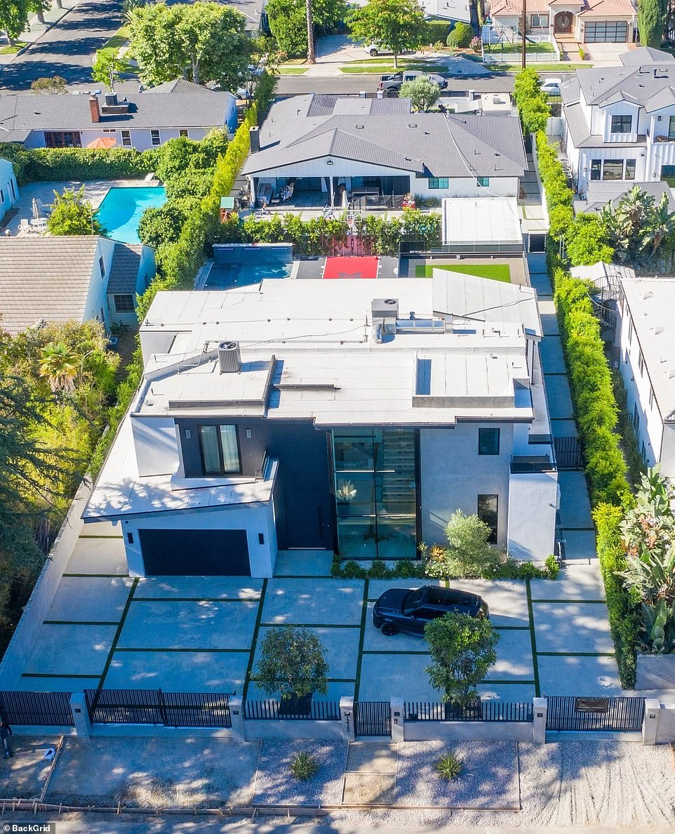 Happy couple: Megan Fox and her boyfriend Machine Gun have moved into a lavish Airbnb for $30,000 per month in Sherman Oaks, just weeks after sparking engagement rumors as their whirlwind romance continues to heat up; seen in 2021