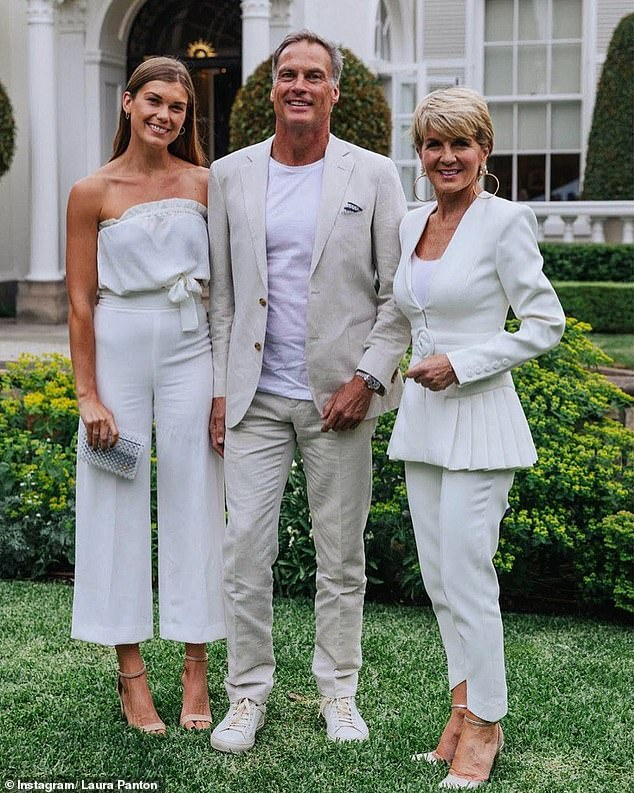 Star on the rise: Melbourne-based socialite Laura Panton is making a name for herself in the pharmaceutical world. Pictured left with her father David and his partner Julie Bishop