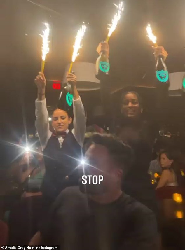 What a night: In a festive twist, sparklers were attached to neon lighted bottles and Amelia was so overwhelmed that she captioned the video: