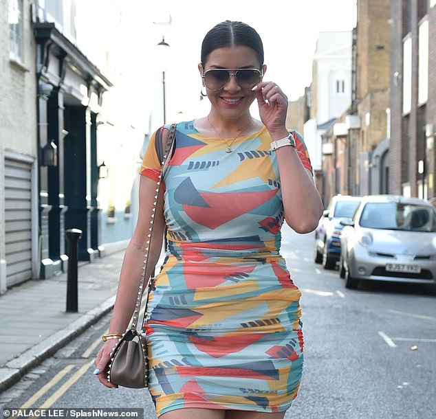 Style: The reality TV star, 38, showcased her toned physique on the outing as she donned a bodycon mini dress with a multi-colored print