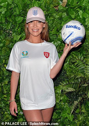 Baseball cap: The TV star was also sporting a white baseball cap and kept her sporty vibe going strong in a pair of white trainers