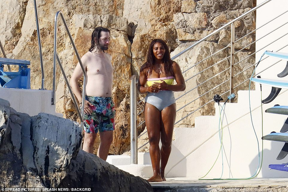 Quality time: Alexis donned a pair of brightly coloured swimming shorts while Serena opted for a striking one-piece