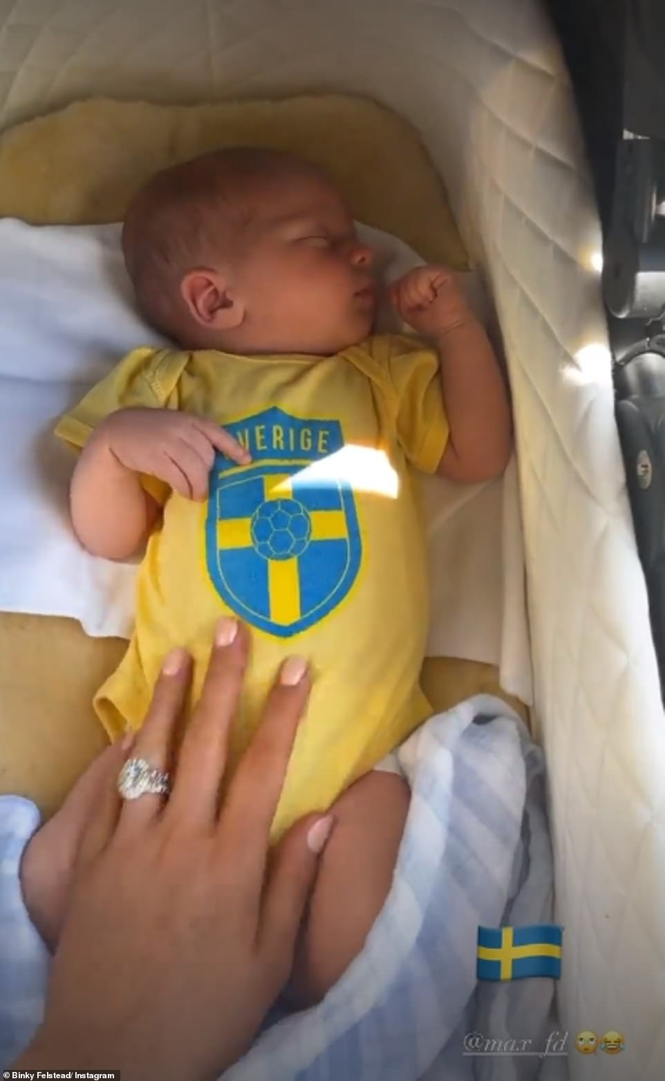 Adorable:For the occasion, the mother-of-two dressed her newborn, whose full name is Wulfric Alexander Fredrik Darnton, in a sweet Swedish football babygrow in a nod to her Scandinavian heritage
