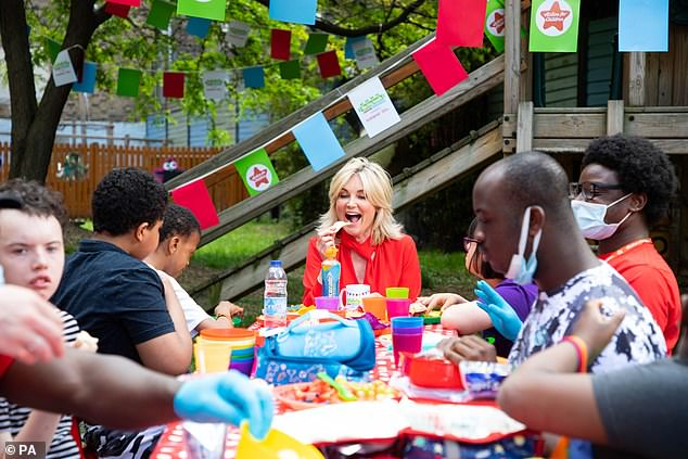 Well wisher:Turner said: 'I am absolutely overjoyed to be part of Action for Children's Big Lunch, celebrating the wonderful Action for Children family'