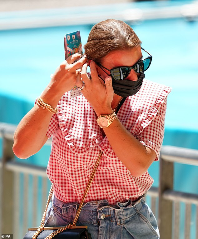 Not her first rodeo: Coleen is no stranger to cheering for England from the sidelines after spending many years supporting her footballer beau Wayne at matches