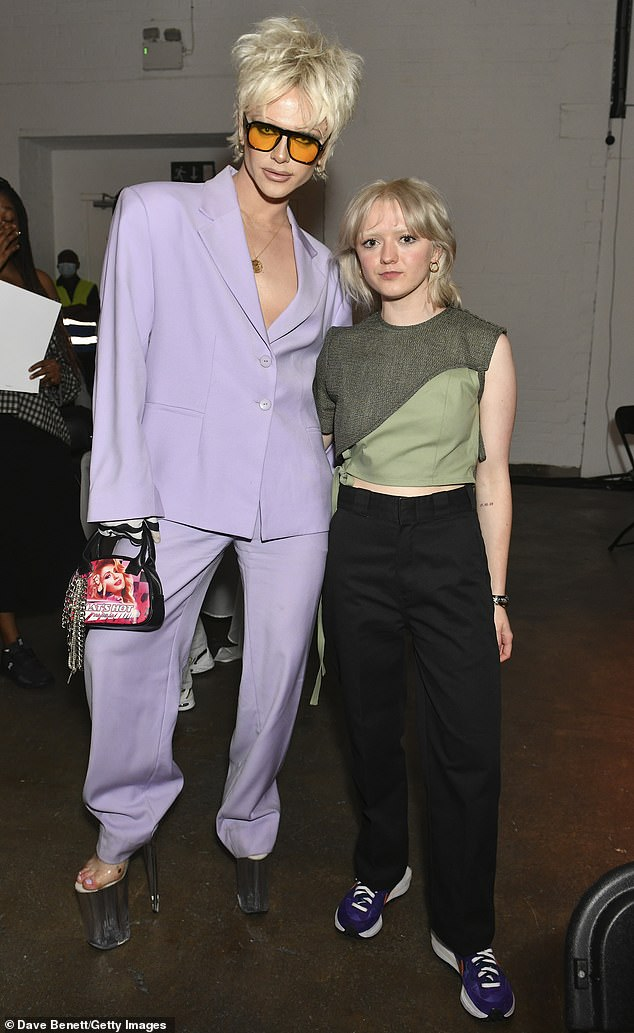 Cool: Known for their striking outfits, Bimini looked right at home at the fashion show wearing a mauve loose-fitting tracksuit and some enormous platform heels