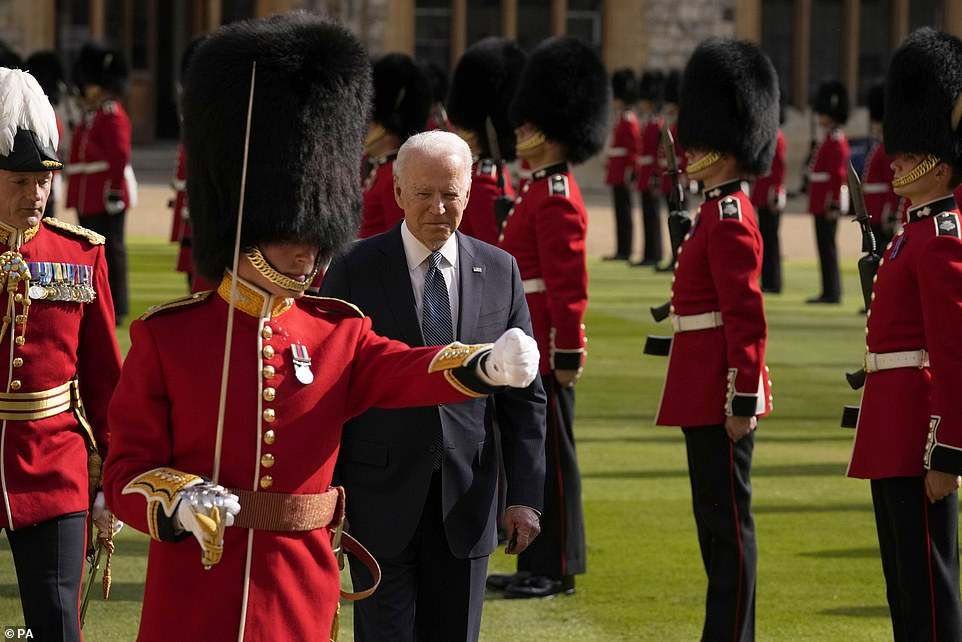 US President Joe Biden inspects the ranks of a Guard of Honour formed of The Queen's Company First Battalion Grenadier Guards during a visit to Windsor Castle
