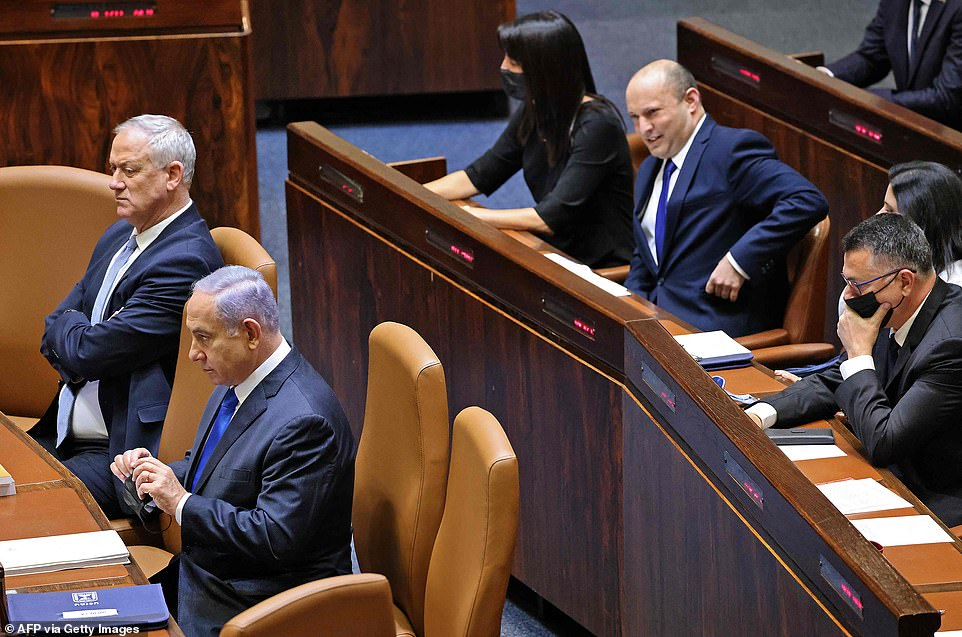 Ahead of the vote, a parliamentary debate became heated as Netanyahu vowed to 'topple' the new coalition, which is led by Bennett