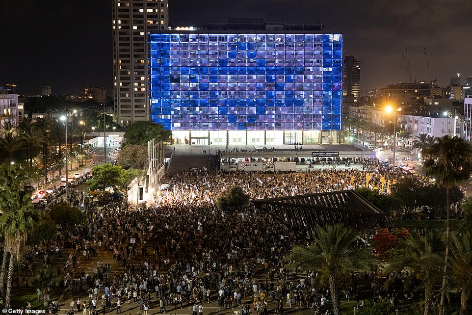 Thousands of people gather for spontaneous celebrations in Rabin Square in Tel Aviv after the confidence vote on Sunday