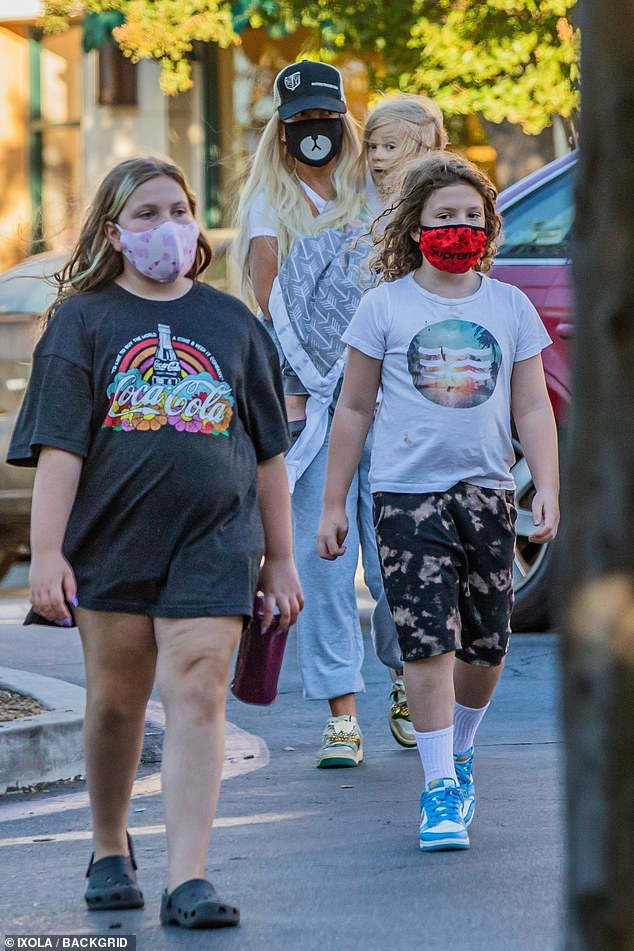 Changing times:The family was out in the upscale Southern California community days ahead of the state's plans to ease restrictions put in place amid the coronavirus pandemic